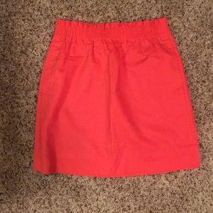 Neon coral jcrew conch waist linen skirt
